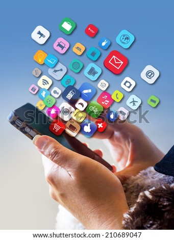 Hand holding the Smartphone with application icons