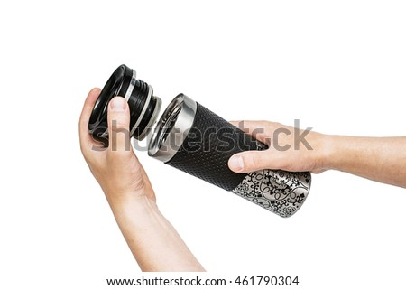 hand holding thermos isolated on white background, Metal thermocup  or thermo cup