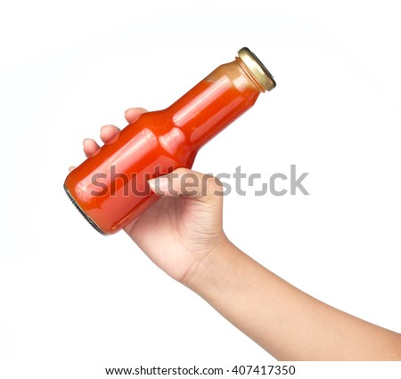 Hand holding Tomato ketchup bottle. Isolated on white background - stock photo