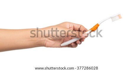 hand holding toothbrush isolated on white background
