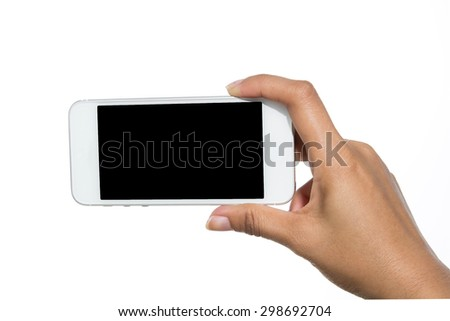 Hand holding touch screen mobile phone. Isolated on white.