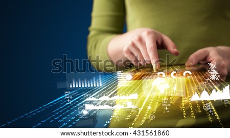 Hand holding touchpad tablet with business market graphs and icons concept on background - stock photo