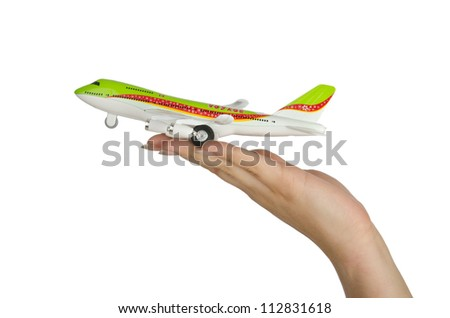 Hand holding toy airplane isolated on white - stock photo