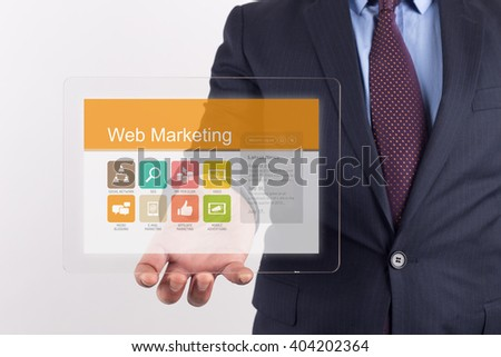 Hand Holding Transparent Tablet PC with Web Marketing screen