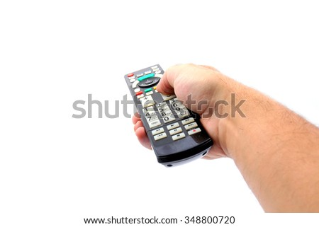 Hand holding TV remote control, isolated on white background - stock photo