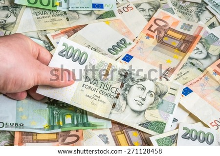 Hand holding two thousand czech crowns on money background - stock photo