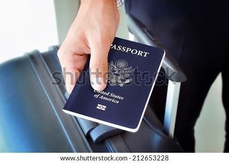 Hand holding U.S. passport - stock photo