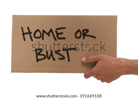 Hand holding up a cardboard home or bust sign - stock photo