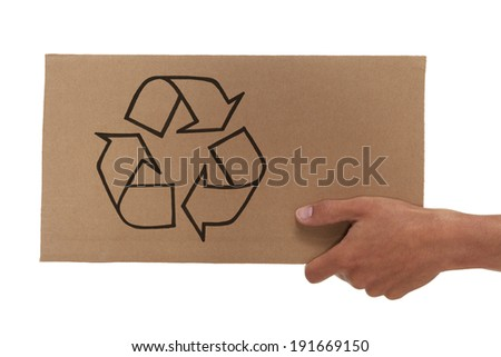 Hand holding up a cardboard recycle sign