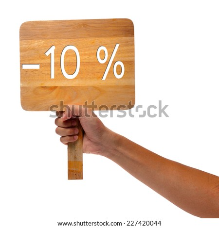 Hand holding up a cardboard -10 % sign  - stock photo