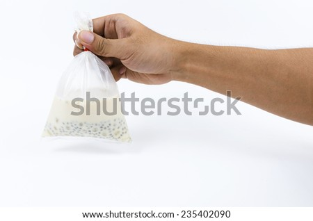 hand holding up a Milk isolated on a white background