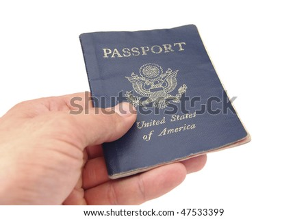 Hand holding US passport - stock photo