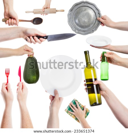 Hand holding various kitchen utensils isolated on white background - stock photo