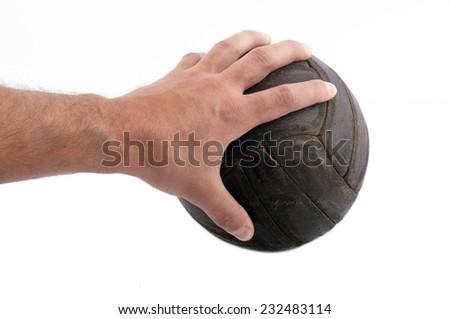 hand holding vintage football - stock photo