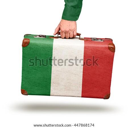 Hand holding vintage Italian flag suitcase isolated on white - stock photo