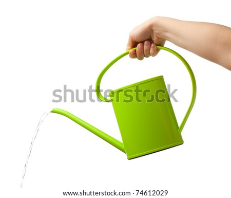 hand holding watering can isolated on white - stock photo