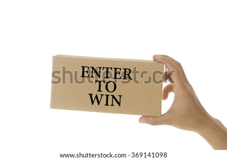 hand holding white card written enter to win over white background