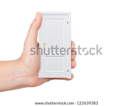 Hand holding white closed door, isolated on white background.