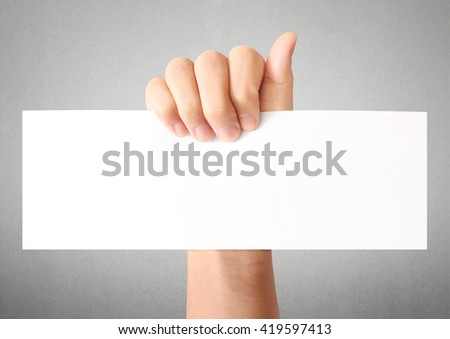 Hand holding white empty a paper
