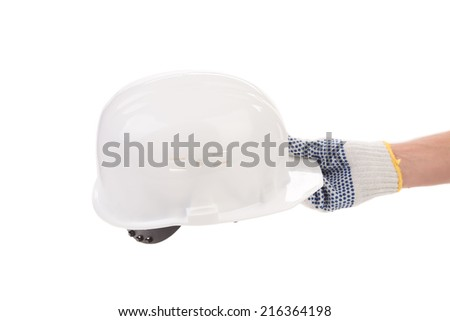 Hand holding white hard hat. Isolated on white background.  - stock photo