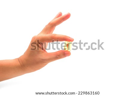 hand holding with Cod liver oil isolated on white - stock photo