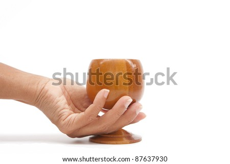 hand holding wood glass