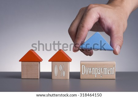 Hand holding wooden house (Housing Loan Concept) with word 0% Downpayment - stock photo