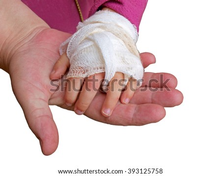 Hand holding wounded baby hand with bandage on white background.