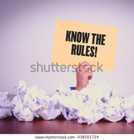 HAND HOLDING YELLOW PAPER WITH KNOW THE RULES!CONCEPT - stock photo
