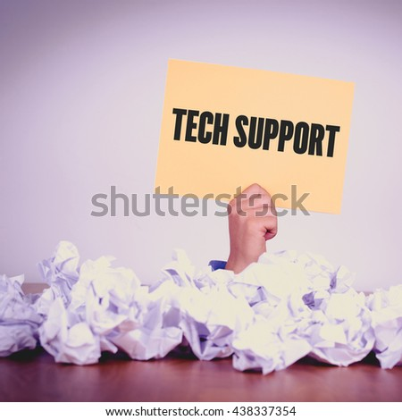 HAND HOLDING YELLOW PAPER WITH TECH SUPPORT CONCEPT - stock photo