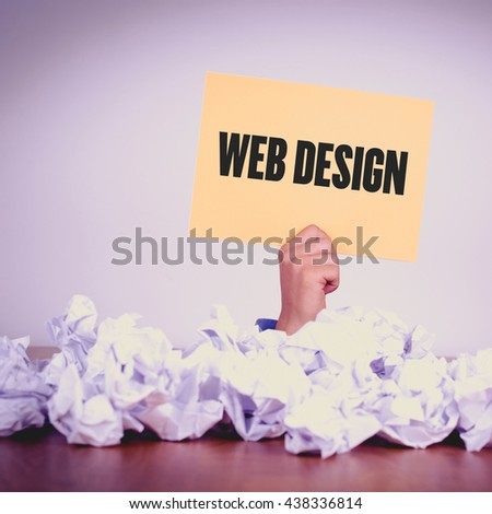 HAND HOLDING YELLOW PAPER WITH WEB DESIGN CONCEPT - stock photo