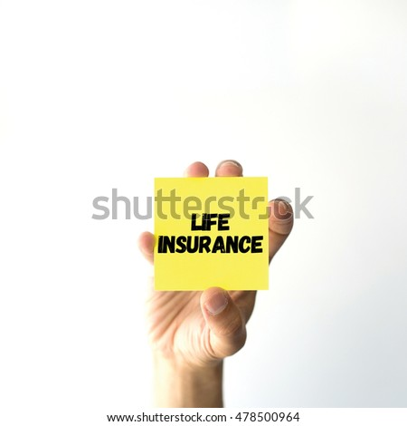 Hand holding yellow sticky note written LIFE INSURANCE word
