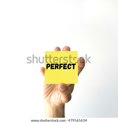 Hand holding yellow sticky note written PERFECT