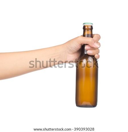Hand holding yellow Whisky Bottle isolated on white background - stock photo