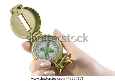 hand holds a compass - stock photo