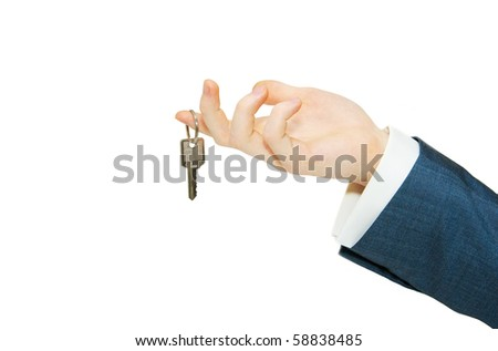 hand holds a key isolated on white