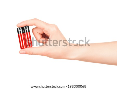 hand holds a red AA battery on an isolated white background - stock photo