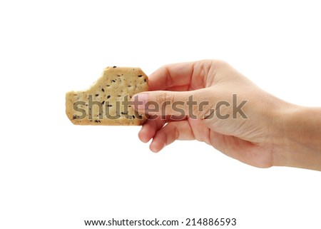 Hand holds Biscuits. Isolated on a white background.