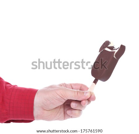 Hand holds bitten chocolate vanilla ice cream. Isolated on a white background - stock photo