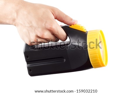 Hand holds black and yellow flashlight - stock photo