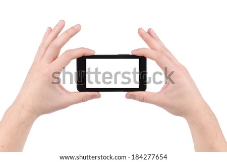 Hand holds cell phone with clipping path. Isolated on a white background. - stock photo