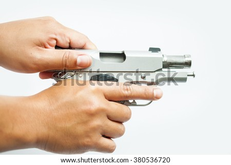 hand holds gun isolated ,selective focus gun - stock photo