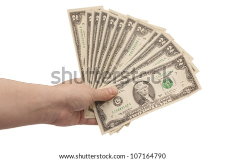 hand holds many paper dollars on white isolated