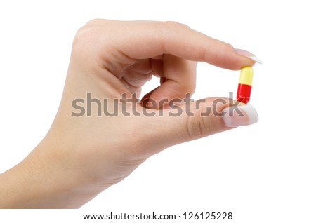 hand holds pill isolated on white - stock photo