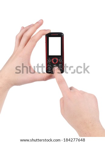 Hand holds red-black cell phone. Isolated on a white background.