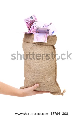 Hand holds sack with euro bills. Isolated on a white background. - stock photo