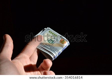 hand holds some dollars banknotes