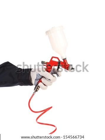 Hand holds spray gun. Isolated on a white background. - stock photo