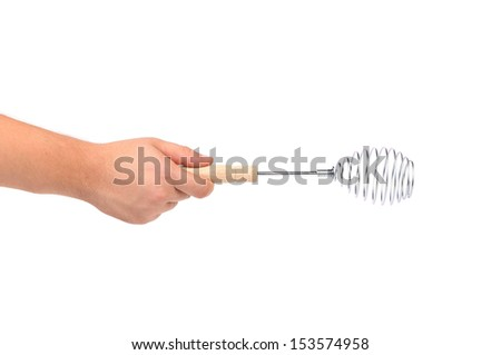 Hand holds Stainless Steel Whisk - stock photo