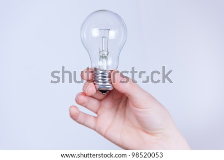 hand holds the electrical lamp not isolated